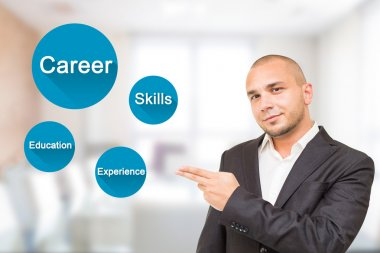 Young handsome man shows important attributes in career