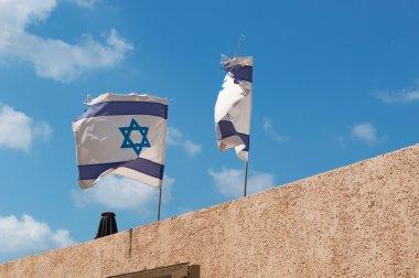 Tel Aviv, Israel: two waving flags of Israel