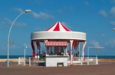 Tel Aviv, Israel, Middle East: the First Hebrew Carousel, the First Hebrew Carousel built in 1932, a merry-go-round overlooking the crashing waves at the Namal, the port of Tel Aviv