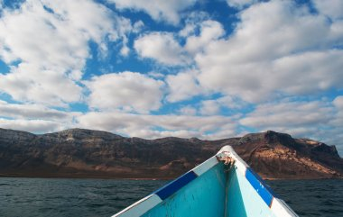 On a boat to Shauab beach, mountains, sands, western cape, Socotra, Yemen