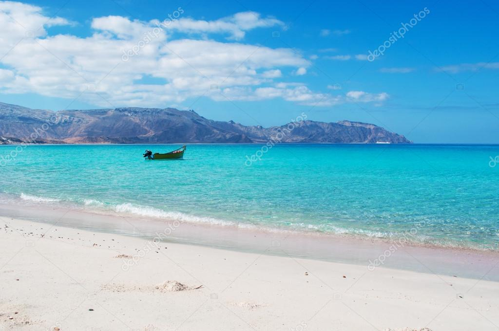 Socotra, Yemen, Middle East: the breathtaking landscape with a boat on the beach of Ras Shuab, Shuab Bay beach, one of the most famous beaches of the island of Socotra, in a secluded cove of the Arabian Sea