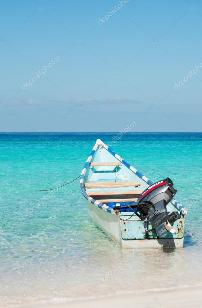 Socotra, Yemen, Middle East: the breathtaking landscape with a motorboat on the beach of Ras Shuab, Shuab Bay beach, one of the most famous beaches of the island of Socotra, in a secluded cove of the Arabian Sea