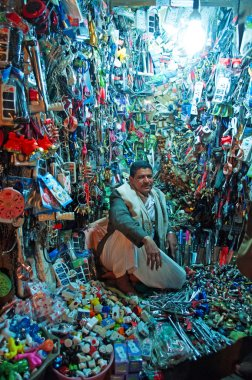 A yemeni man, seated in his shop in the salt market of the Old City of  Sana'a, suq, Yemen, seller, tools, daily life