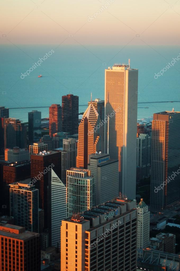 Chicago: skyline at sunset seen through the glass of the Willis Tower observation deck