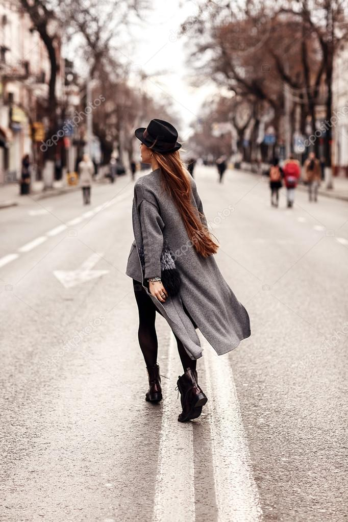 fashion portrait of a beautiful girl on the streets