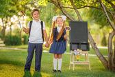 Photo Schoolchildren with backpacks outdoors