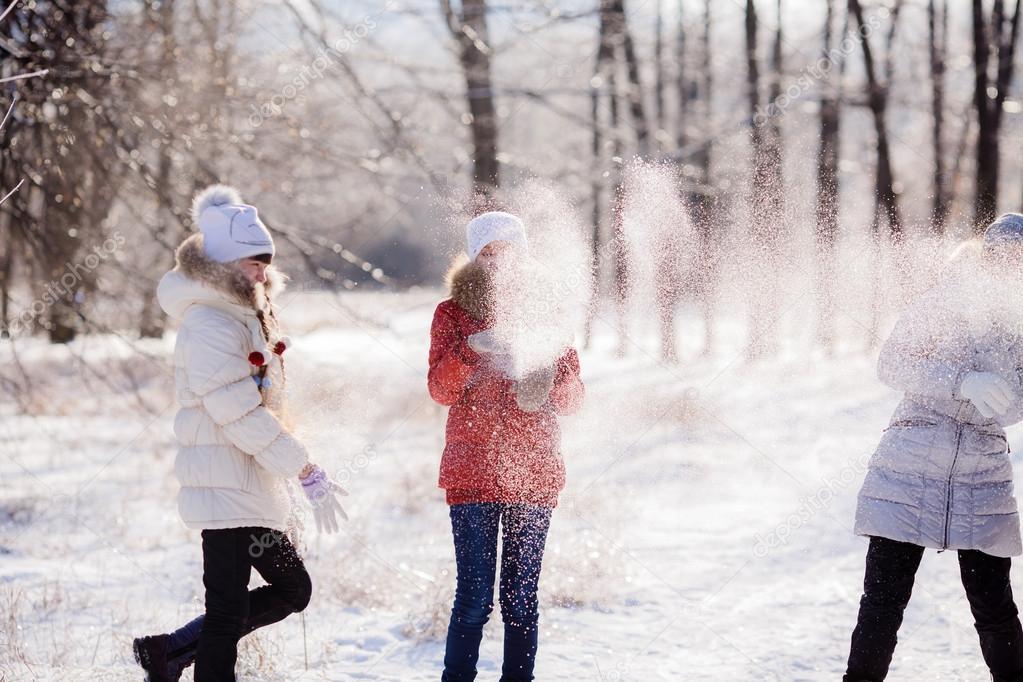 Happy kids throwing snow
