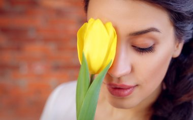 Beautiful girl with tulip.