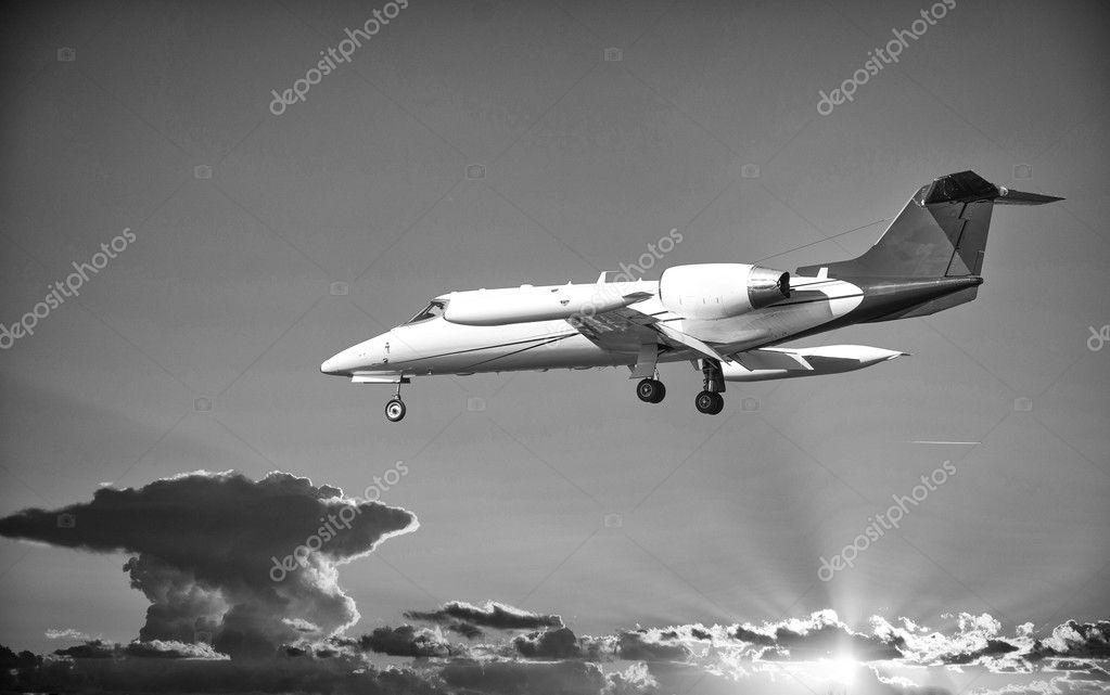 Private jet plane in a beautiful sky.
