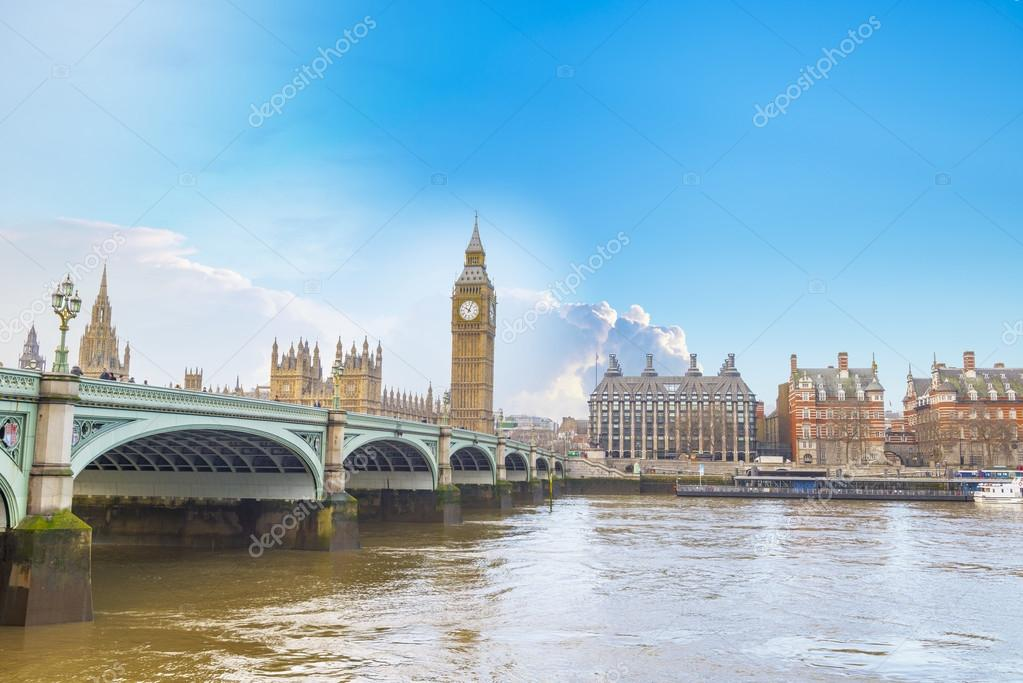 Big Ben and Houses of Parliament with bridge and thames river in