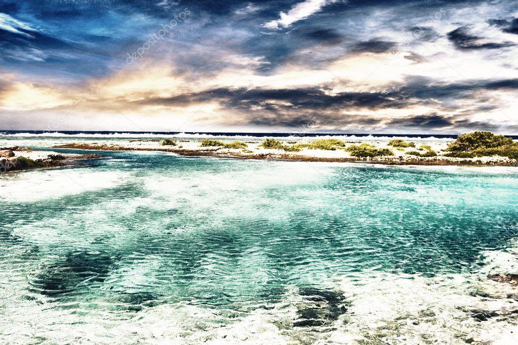 Polynesian sea and coast under dramatic sky