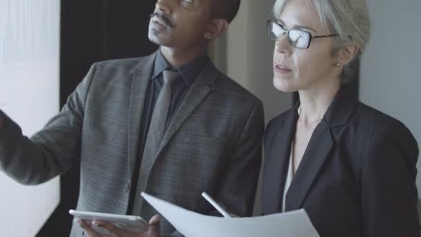 Professional investors or traders analyzing statistics