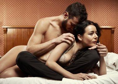 Loving couple in bedroom