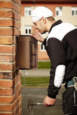 Professional checking chimney