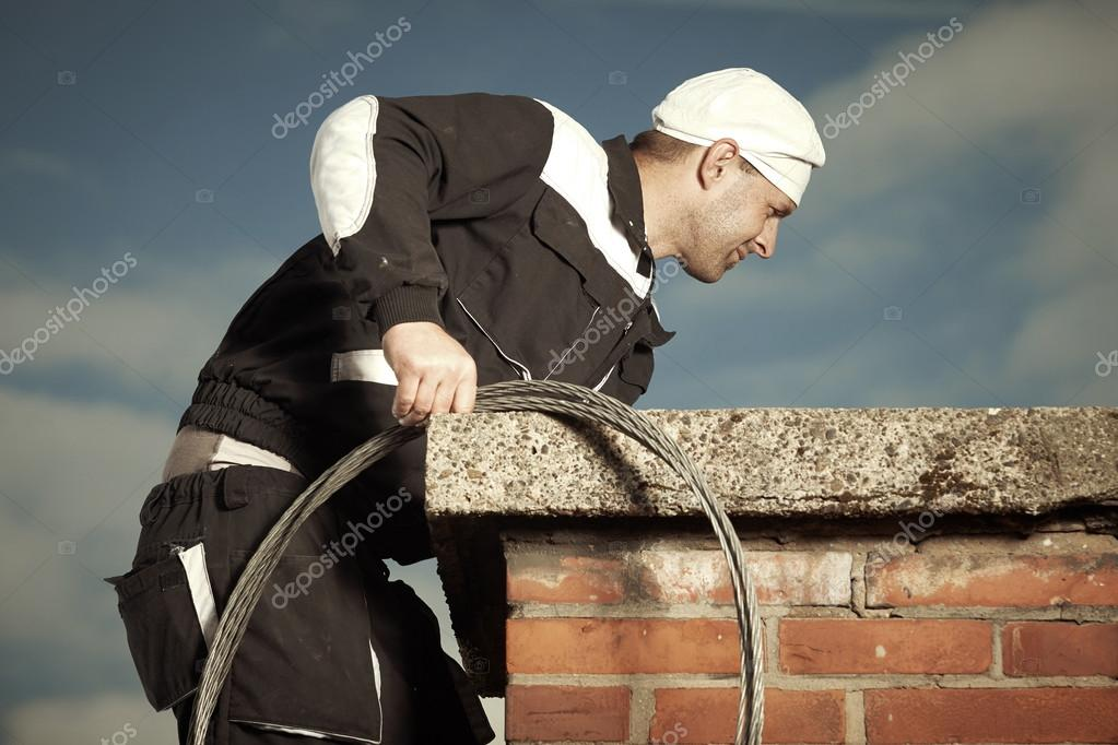 Chimney sweep man in uniform