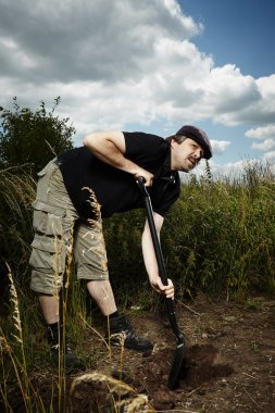 Man working outdoor on hiding place