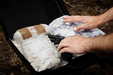 Man hiding drugs in suitcase