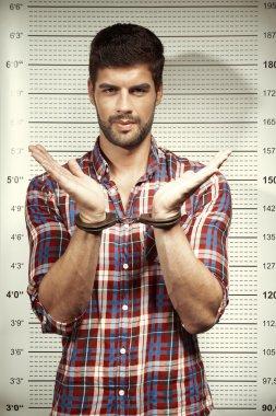 Criminal man in handcuffs