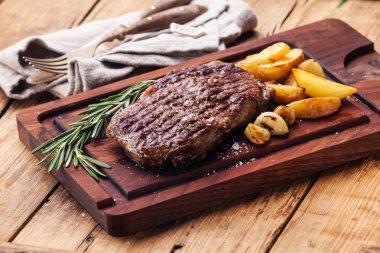 Medium rare grilled Beef steak Ribeye with roasted potato wedges