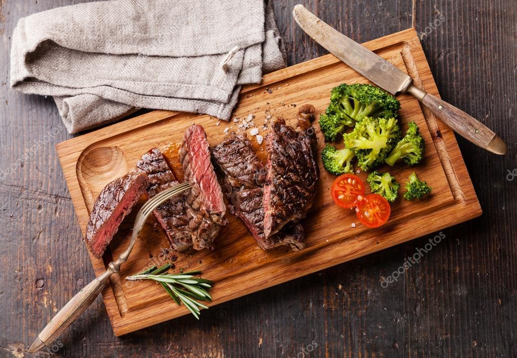 Sliced medium rare grilled Beef steak Ribeye with broccoli