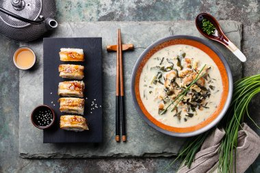 Creamy soup with Eel and sushi rolls