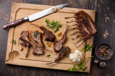Roasted lamb ribs and kitchen knife