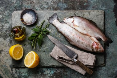 Raw Trout fish with spices and herbs