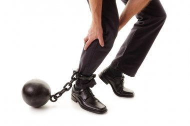 Ball and chain restraining businessman