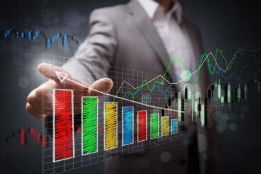 Businessman pointing to growth chart