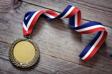 Gold medal on wood background