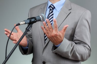 Speech with microphone and hand gesture