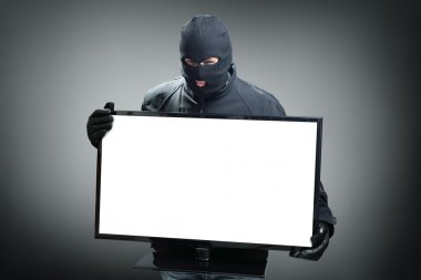 Thief stealing computer monitor