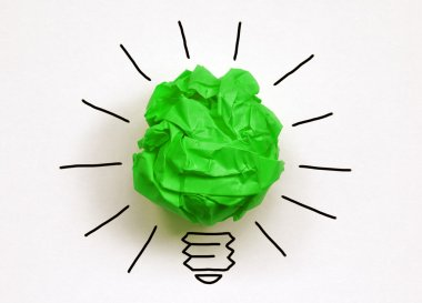 Crumpled green paper light bulb metaphor