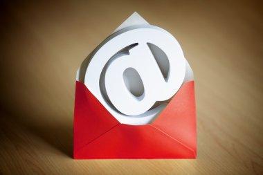 E-mail symbol inside a red envelope