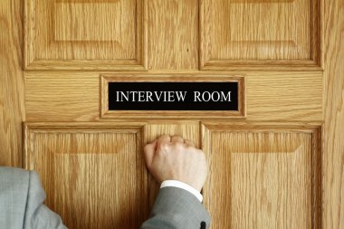 Businessman knocking on interview room