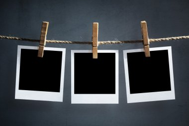 Blank photographs hanging on a clothesline