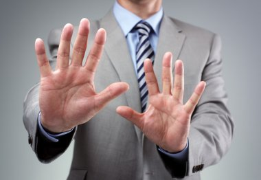 Stop or fear gesture from businessman
