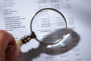 Magnifying glass on financial report