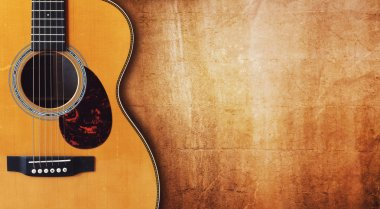 Acoustic guitar against  grunge background