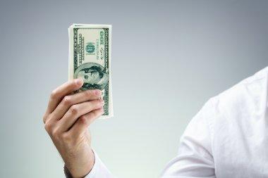 Businessman holding one hundred dollar bills