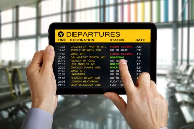 Digital tablet in airport with flight information