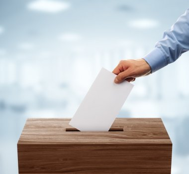 Ballot box with man casting vote