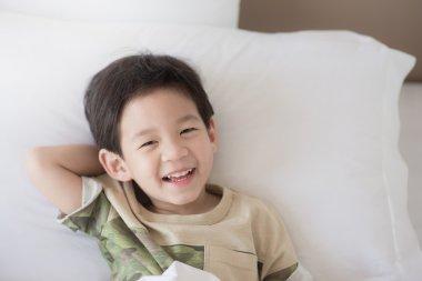 Cute asian child lying