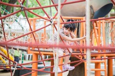 Asian girl is having fun in adventure park
