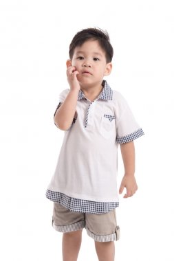 Cute asian child scratching