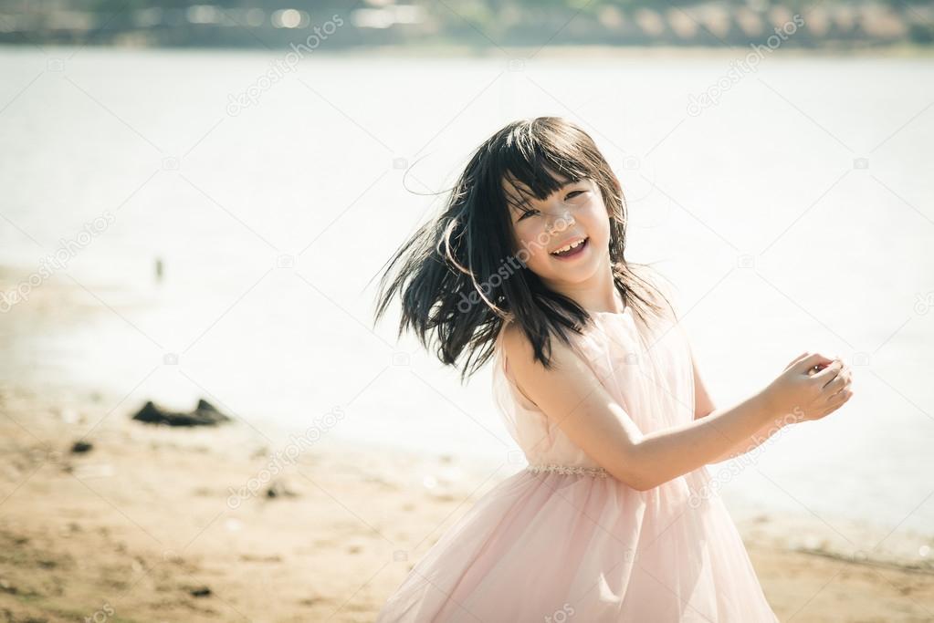 Beautiful asian girl smiling on the beach