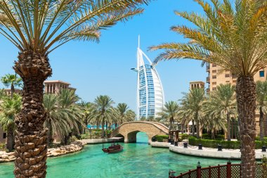 Burj Al Arab hotel Madinat Jumeirah in Dubai with palm trees