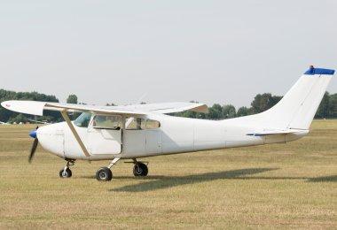 airplane landing in field