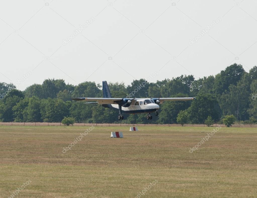 Airplane landing in field
