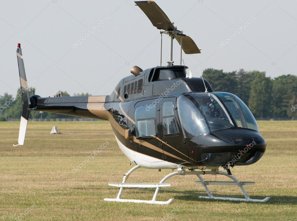 Helicopter in green field